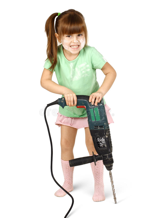 Boos kindmeisje met elektrische boor royalty-vrije stock foto