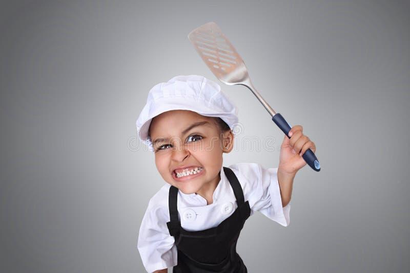 Boos weinig chef-kok royalty-vrije stock fotografie