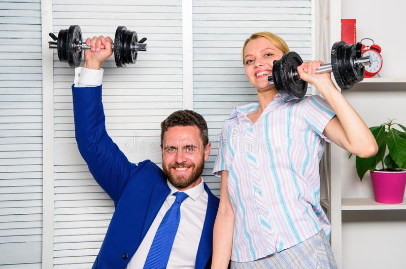Boost sales with strong strategy. Good job concept. Boss businessman and office manager raise hand with dumbbells. Boost. Business team. Boost your skill. Man stock images