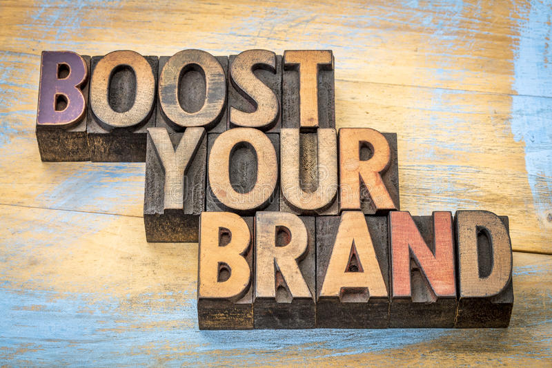 Boost your brand in letterpress wood type. Boost your brand - word abstract in vintage letterpress wood type stained by color inks royalty free stock image