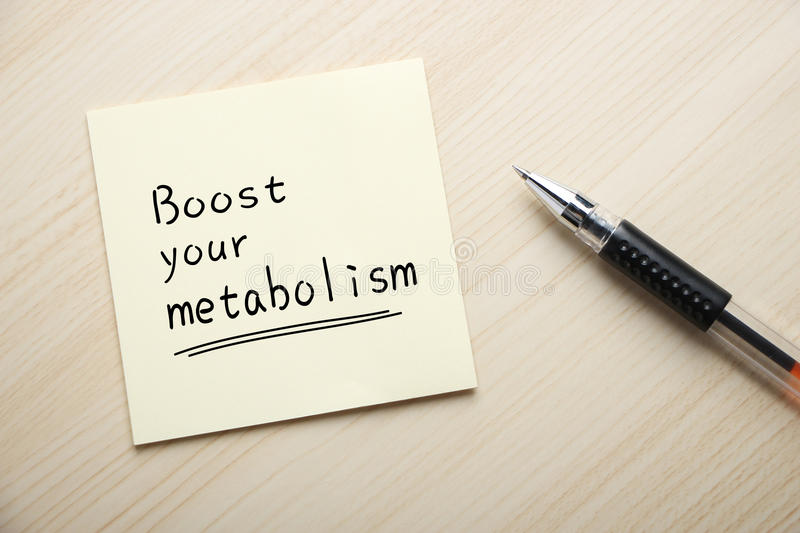 Boost Your Metabolism. Text Boost Your Metabolism written on the sticky note with pen aside royalty free stock images