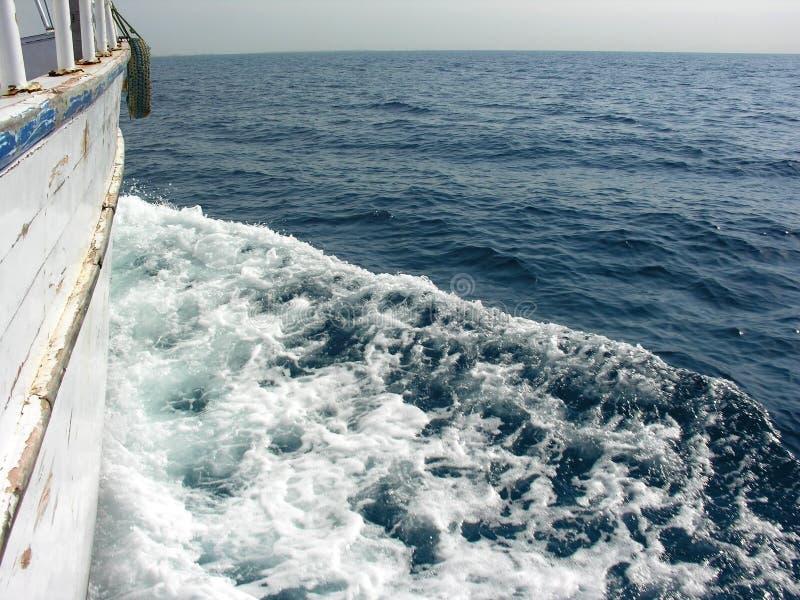 Boot aan horizon stock foto's