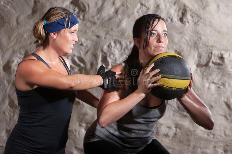 Boot Camp Workout Training with Medicine Ball. Serious boot camp workout coach with athlete and medicine ball stock photo