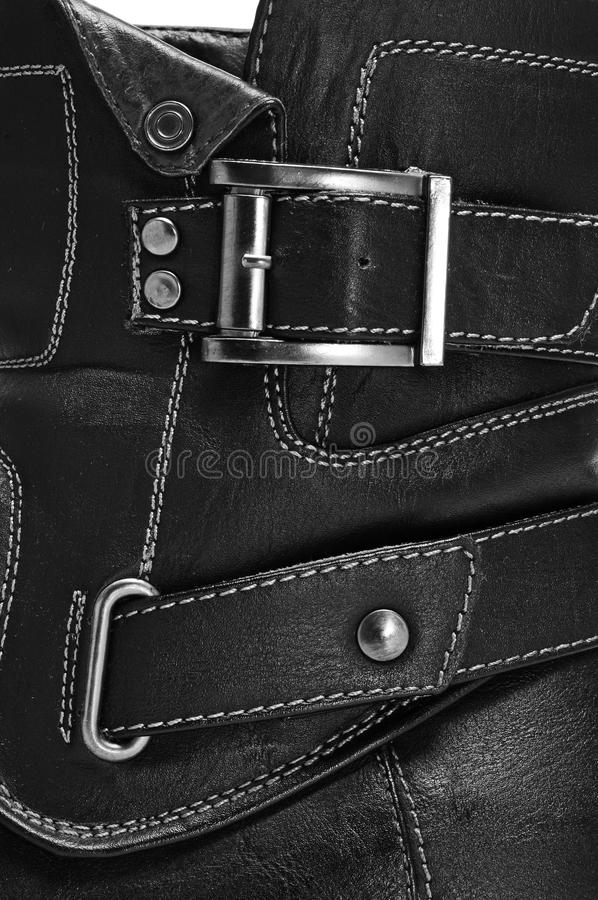 Boot. Closeup of a black leather boot with straps stock photography