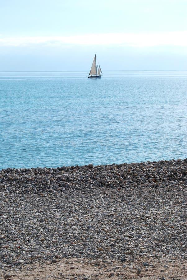 Boot en strand stock fotografie