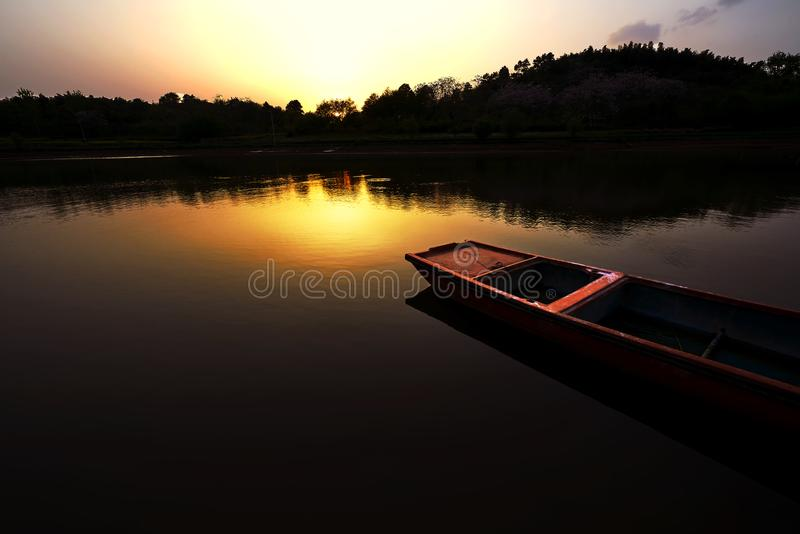 A boot in the lake. In the dusk, near sunset royalty free stock photos
