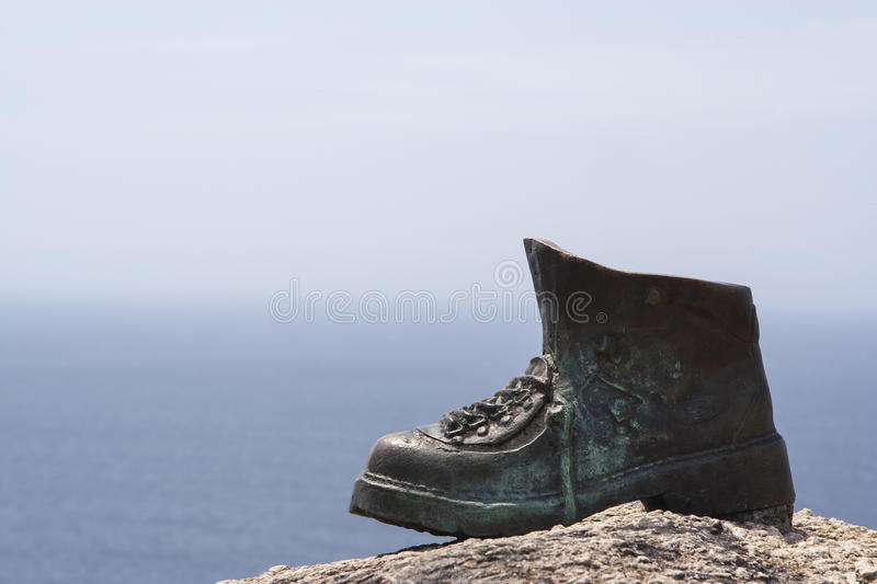 Boot on the rock stock photography