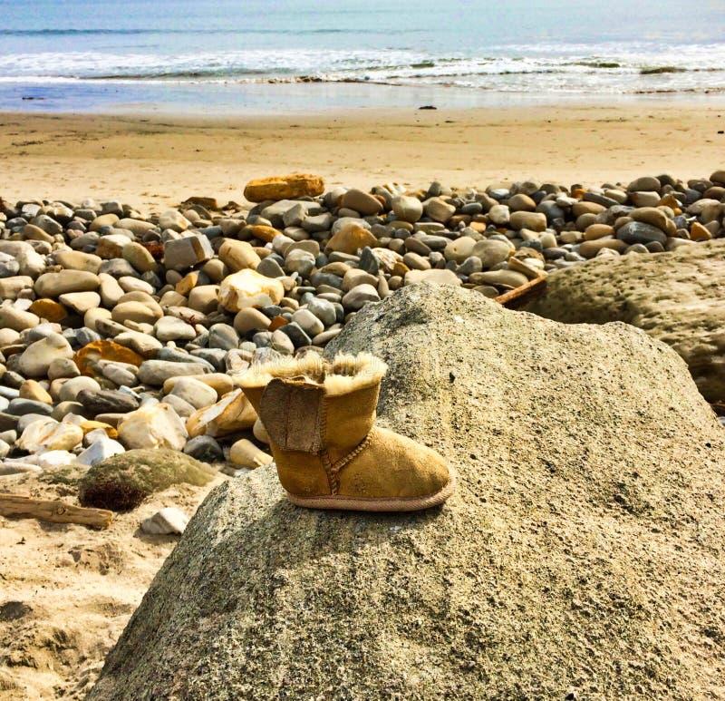 Boot rock ocean stock photography