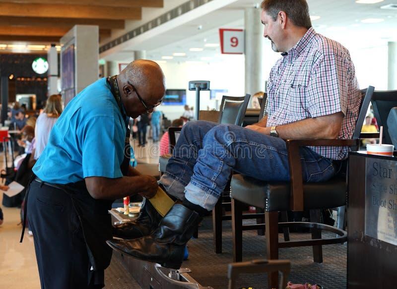 Boot shine - Dallas airport stock photography