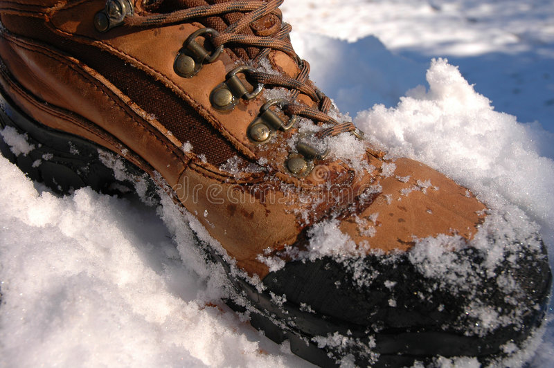 Boot in Snow. Walking thru snow royalty free stock photography