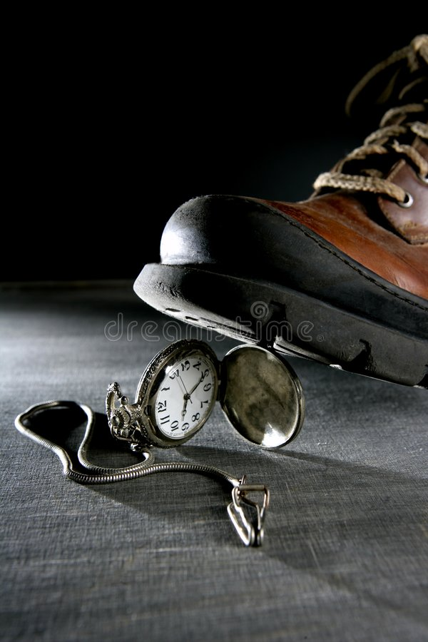 Boot Treading An Old Pocket Silver Watch Royalty Free Stock Photo
