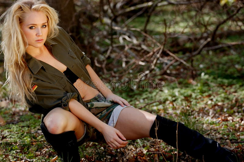 Bootcamp girl army style. Beautiful bootcamp girl in army style fatigues stock photography