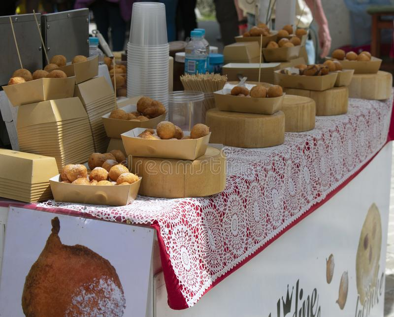 A booth with fritters. Istria, Croatia - April 22nd, 2019 - A booth with fritters at the wine festival royalty free stock photos