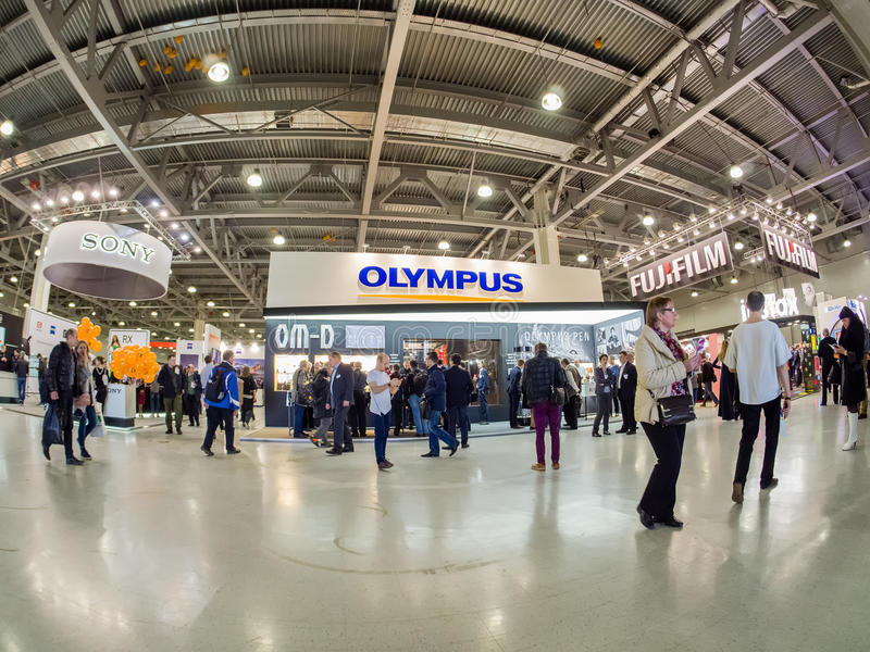 Booth of Olympus company at PhotoForum 2017 trade show. MOSCOW, RUSSIA - APRIL 21, 2017: Booth of Olympus company at PhotoForum 2017 trade show and exhibition in royalty free stock photo