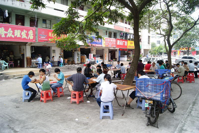 In the booth to eat. China's shenzhen, noon the workers after work, in the booth about to have lunch stock photo