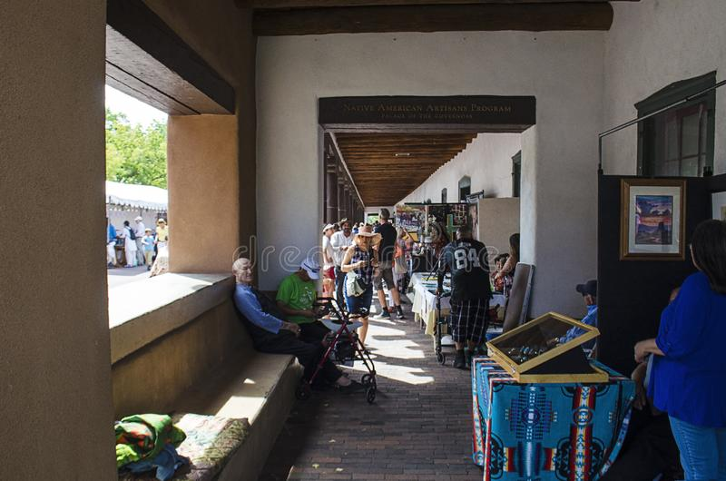 Booths line the Governors Palace along the plaza in Santa Fe New Mexico stock photos