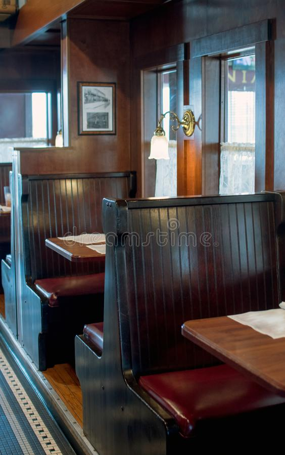 Booths in a train car restaurant. A restaurant in an old train car, serves food in cute renovated booths royalty free stock photography