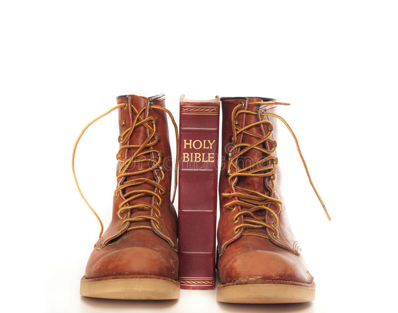 Boots And Bible Isolated Against White Royalty Free Stock Images