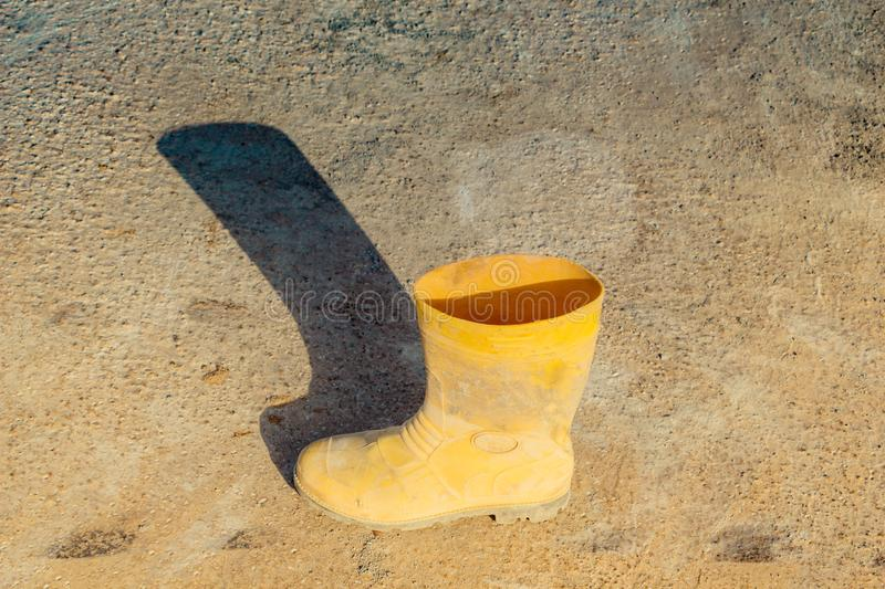 Boots an concrete texture as grunge background stock photos
