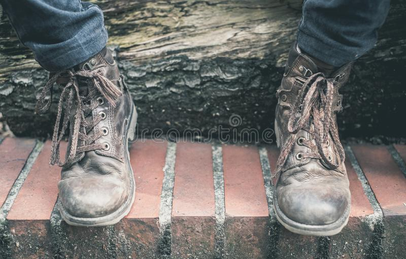 Boots and contrast made of wood stock photos