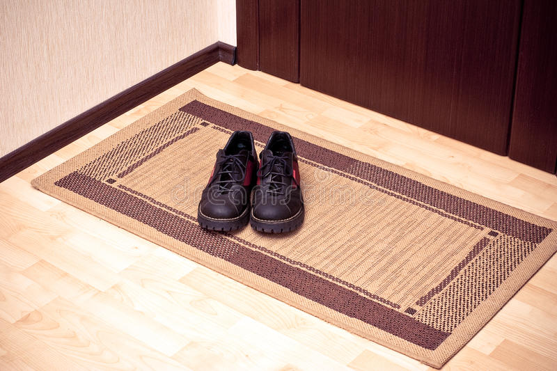 Download The boots on the door-mat stock photo. Image of boots - 11497224