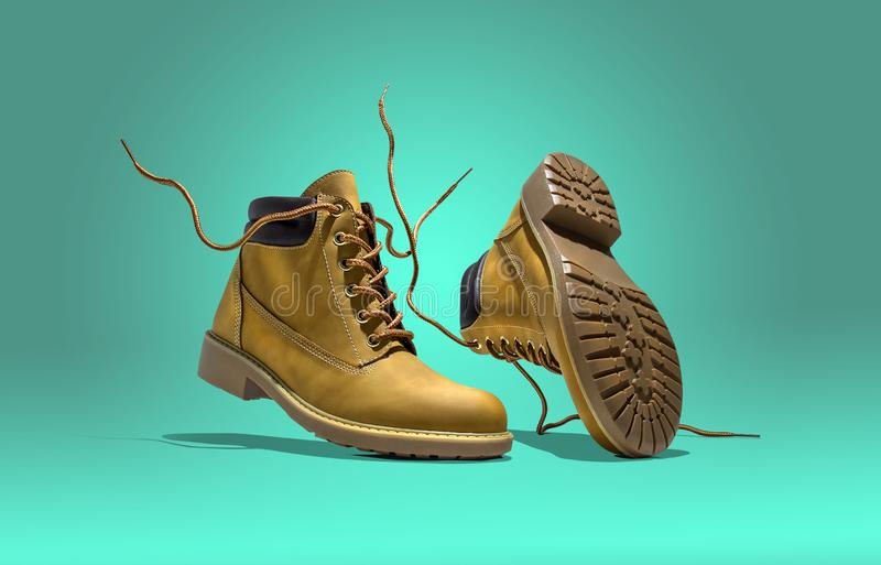 Boots falling on a bright full colored background aqua royalty free stock image