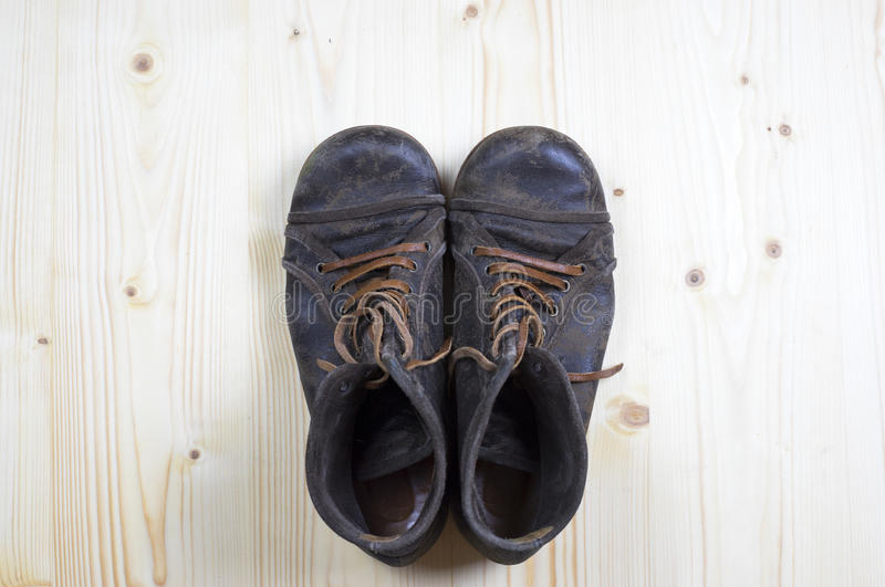 Boots on flat pine wood 2 royalty free stock photography