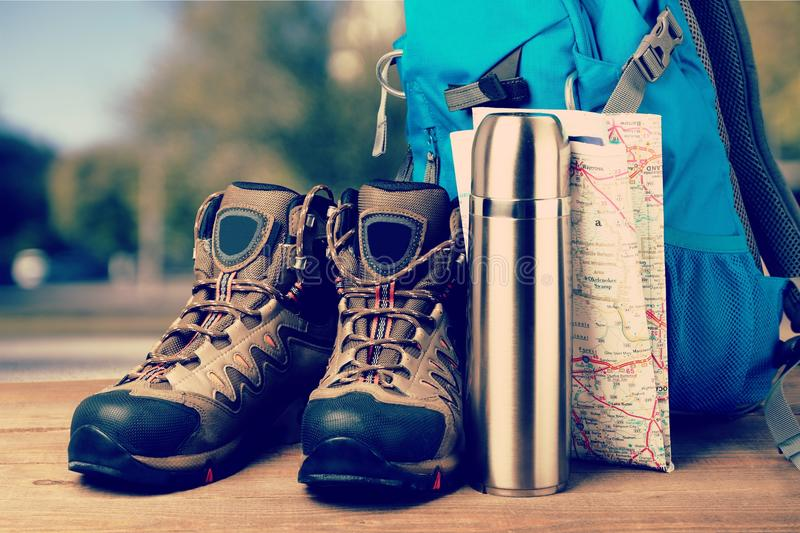 Hiking boots, compass and map on background. Boots hiking compass map sport activity recreational stock images