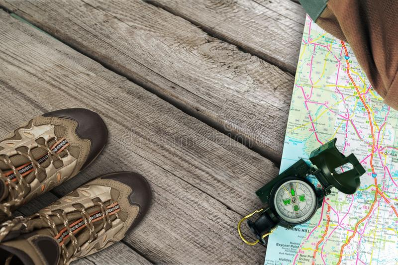 Hiking boots, compass and map on background. Boots hiking compass map sport activity recreational royalty free stock photos