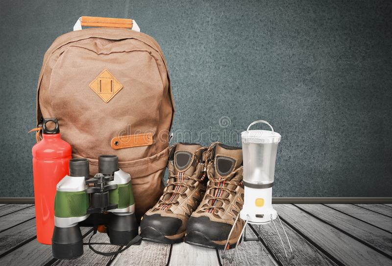 Hiking boots, lantern and binoculars on background. Boots hiking map sport activity recreational background stock photo