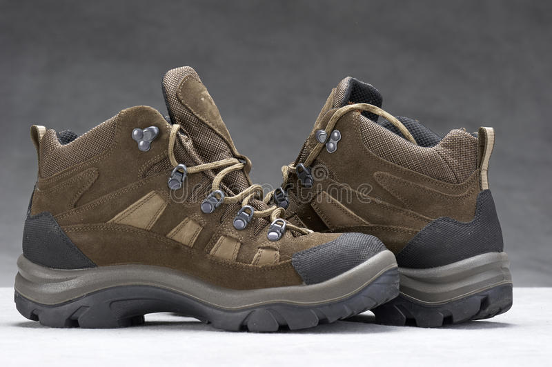 Boots(hiking). Pair of brown, ankle high hiking boots stock photo