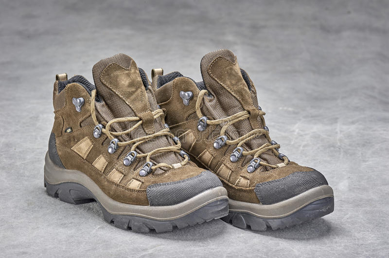 Boots(hiking). Pair of brown, ankle high hiking boots royalty free stock photo