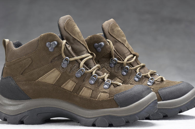 Boots(hiking). Pair of brown, ankle high hiking boots royalty free stock photography