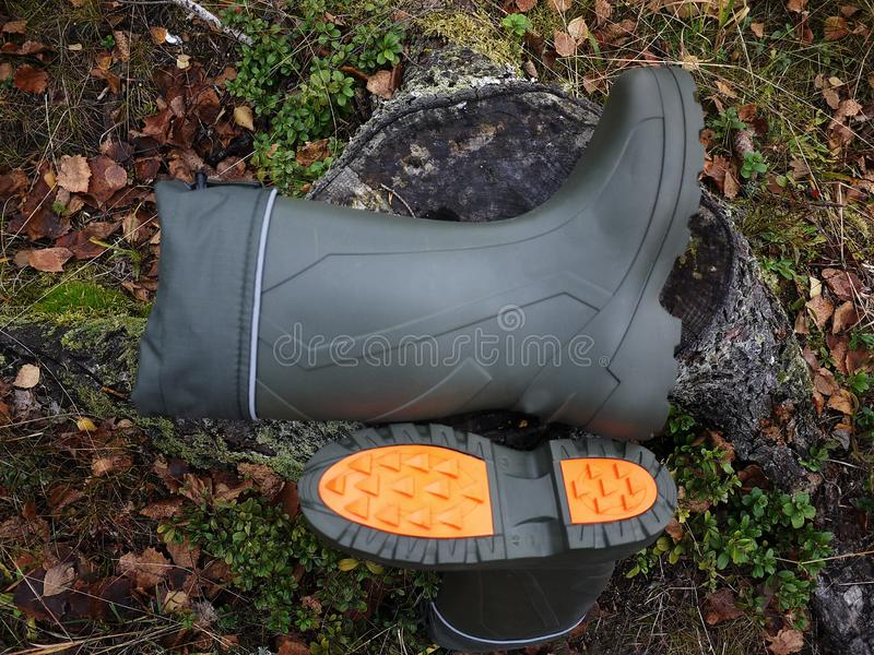 Boots for hunter and fisherman. Suitable for hunting and fishing, for outdoor travel.  Details royalty free stock image