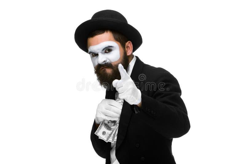 Boots na als zakenman die geld in zijn zak zetten stock foto's