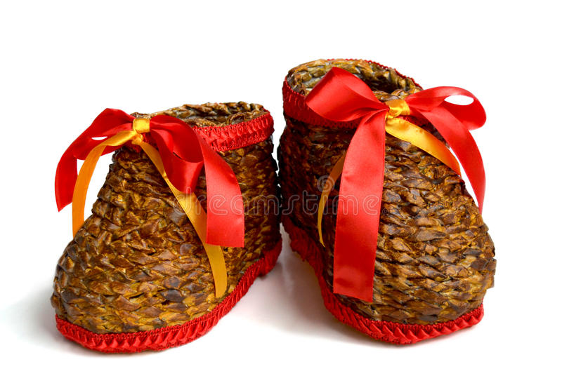 Boots3. A pair of handmade weaving boots with red ribbon royalty free stock image
