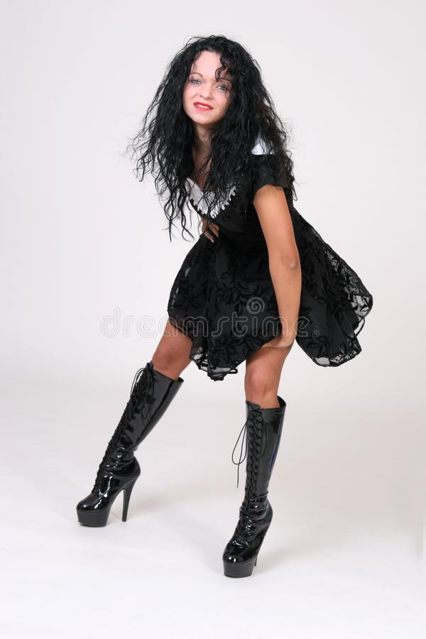 Boots and showy dress stock images