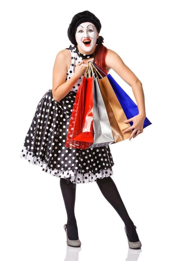 Boots in spotty kledingsholding het winkelen zakken na stock fotografie