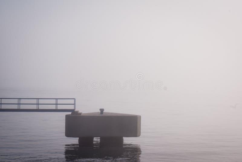 Spain Andalusia Malaga Boat Dock Sea and Fog Harbor Fog royalty free stock images