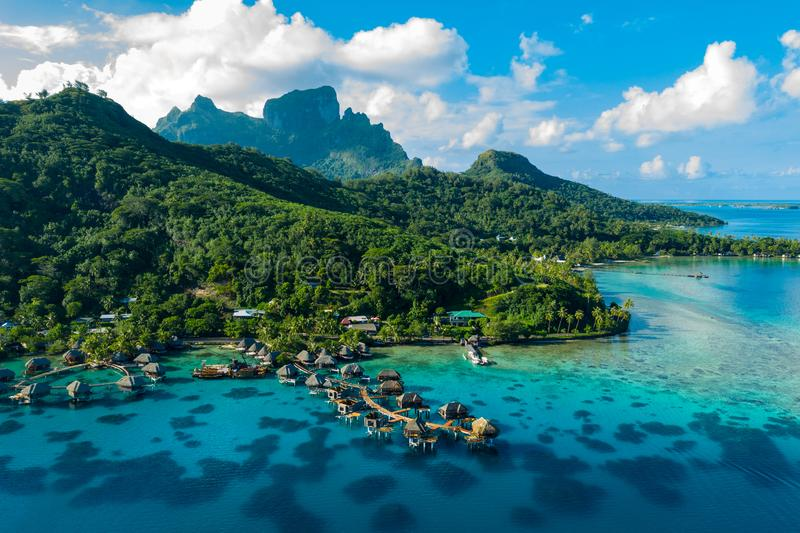 Bora Bora aerial drone image of travel vacation paradise and overwater bungalows royalty free stock images