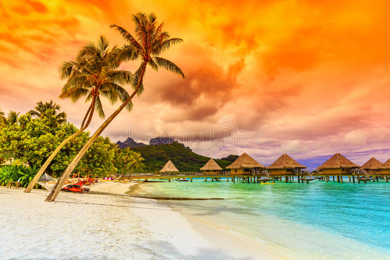 Bora Bora, French Polynesia. Otemanu mountain, beach and palm trees stock photography