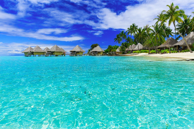 Bora Bora, French Polynesia. Over-water bungalows of luxury tropical resort, Bora Bora island, near Tahiti, French Polynesia, Pacific ocean royalty free stock photo
