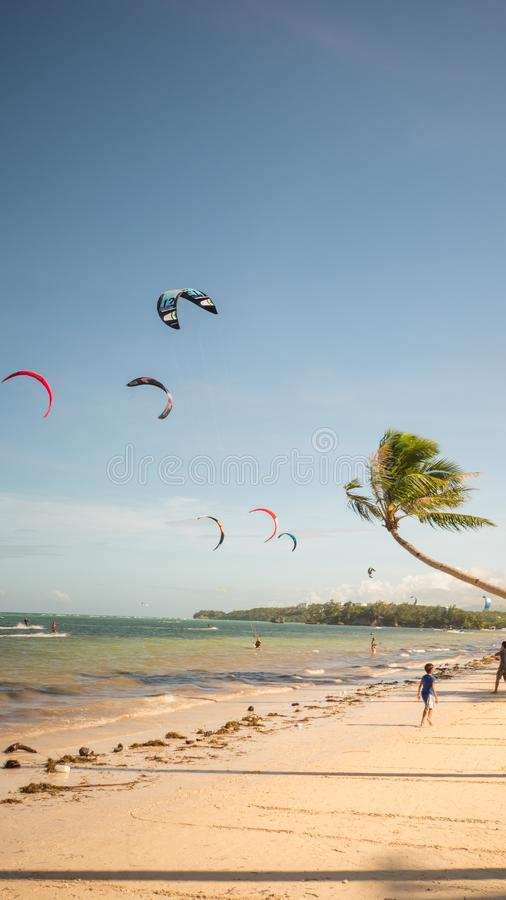 Boracay, Philippines - January 5, 2018: Kiteboarding. People enjoying the energy of the wind on the beach of the island stock photography