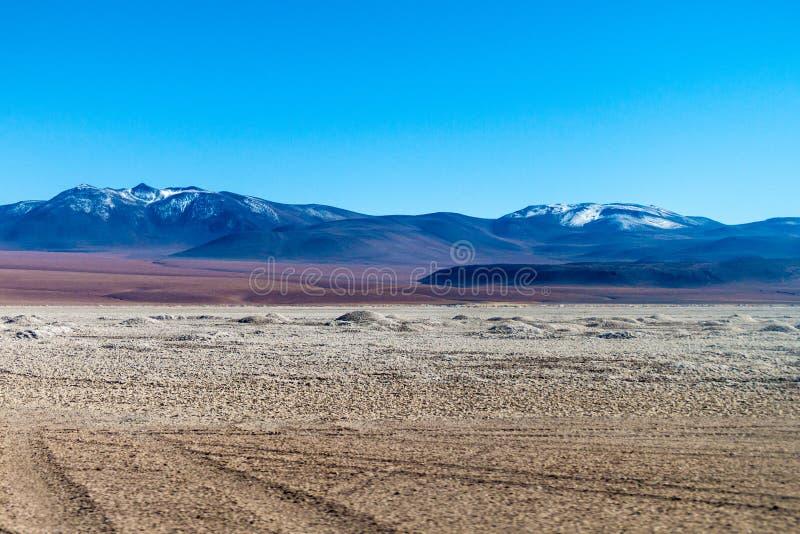 Salar de Chalviri salt flat in Bolivia. Borax is being mined from Salar de Chalviri salt flat in Bolivia royalty free stock images