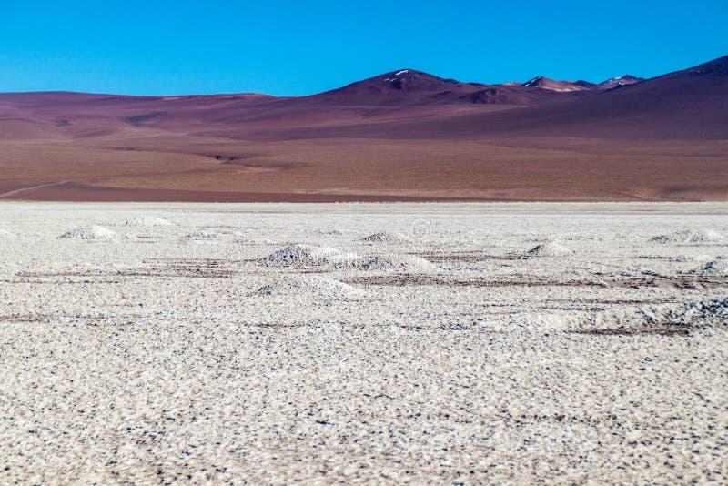 Salar de Chalviri salt flat in Bolivia. Borax is being mined from Salar de Chalviri salt flat in Bolivia royalty free stock image