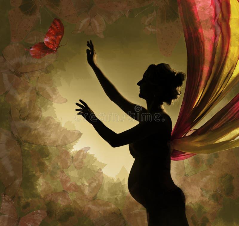 Borboleta de travamento da mulher gravida. foto de stock