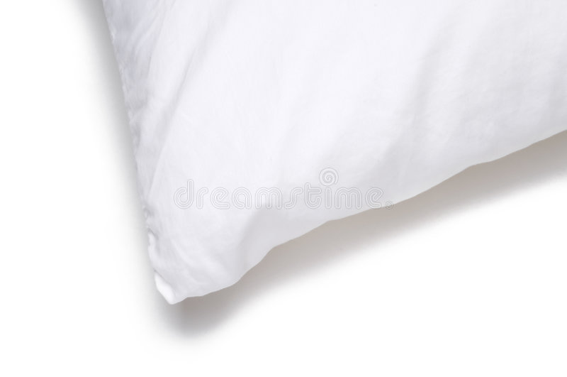 Bord faisant le coin d'un oreiller blanc images stock