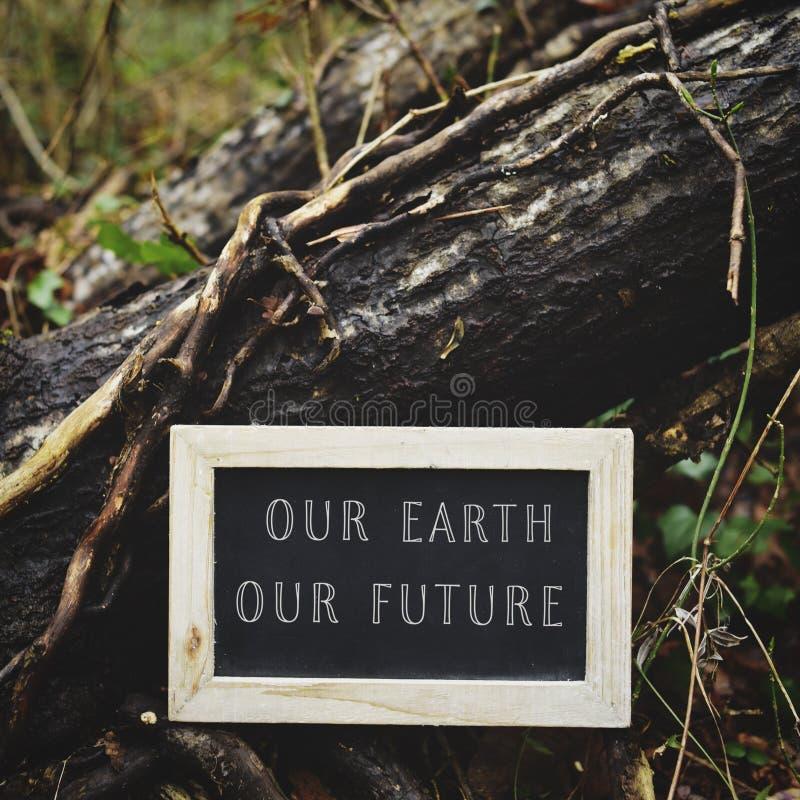 Bord met de tekst onze aarde onze toekomst royalty-vrije stock afbeelding