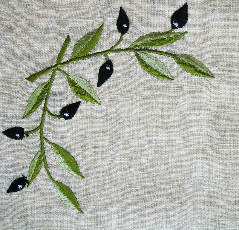 Bordado do ramo de oliveira na tela bege de linho ilustração stock