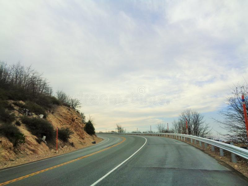 Borde de la carretera del mundo, vuelta del cielo foto de archivo